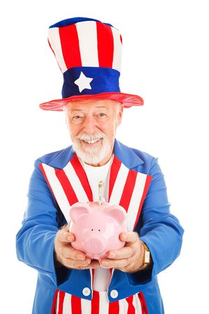 American Uncle Sam holding a piggy bank with a twenty dollar bil sticking out of it.  Isolated on white. photo