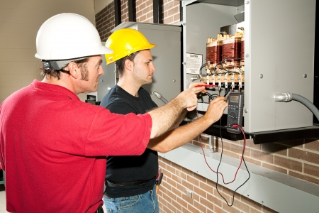 apprentice: Vocational education student learns how to repair an industrial power distribution center.