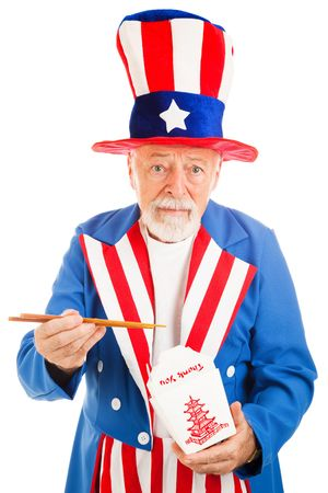 American icon Uncle Sam eating Chinese takeout food with chop sticks.  Metaphor for US debt to China or poor eating habits.   photo