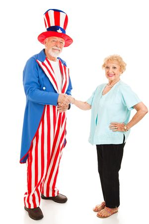 sam: Woman shakes hands with Uncle Sam.  Isolated on white.  Metaphor for citizenship or immigration.  Stock Photo