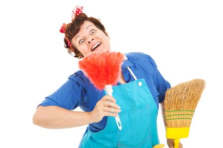 Cleaning lady with a crazy expression plays with her broom and feather duster.  Isolated on white. Stock Photo - 5345000