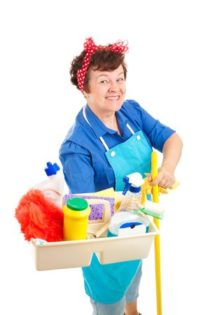 Cheerful cleaning lady holding her tray of cleaning tools and products.  Isolated on white.   photo