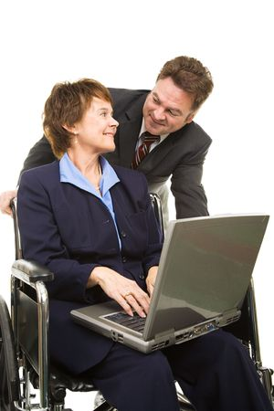 Disabled businesswoman with laptop and her boss having a conversation.  Isolated on white. photo