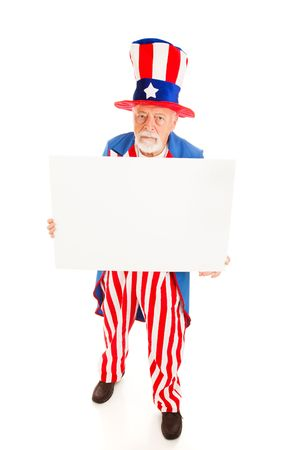 sam: Grumpy Uncle Sam holding a blank sign.  Full body isolated design element. Stock Photo