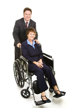 Businessman pushing a disabled businesswoman in her wheelchair.  Full body isolated.