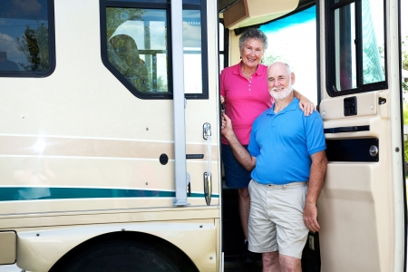 Portrait of senior couple at the door of their recreational vehicle.   photo
