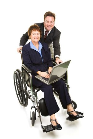 Mature business team working on the computer.  The woman is in a wheelchair.  Full body isolated. photo