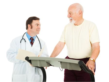 Fit senior man uses a treadmill in his doctors office.  Isolated on white. photo
