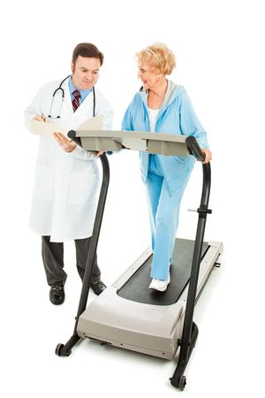 Senior woman exercising on a treadmill while her doctor monitors her progress.  Full body isolated.