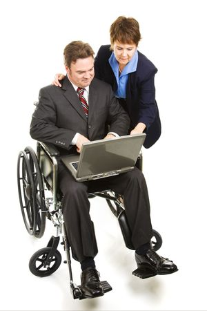Coworker helps a disabled man with his laptop computer.  Full body isolated on white. photo