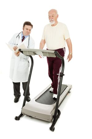 Doctor monitoring a senior man as he walks on a treadmill.  Full body isolated on white. photo