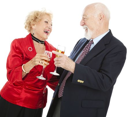 Senior couple celebrating a holiday with champagne.  Isolated on white. photo