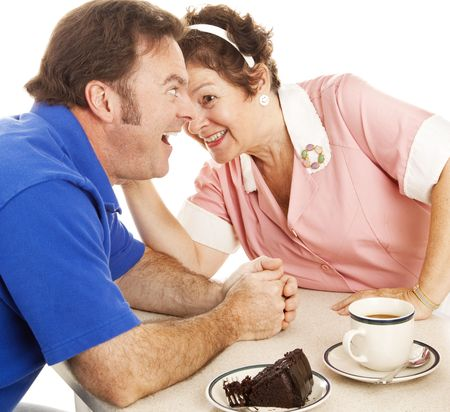Waitress in a diner whispers gossip into her customer's ear.  White background. Stock Photo - 5545007
