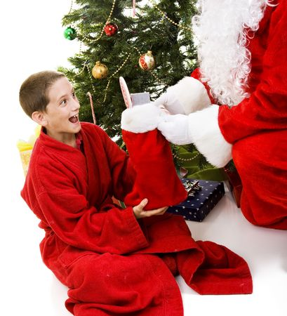 Adorable little boy receives a Christmas stocking from Santa Claus. Stock Photo - 5562888
