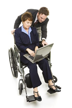 Disabled professional woman and her business partner working on a project together.  Isolated on white. photo