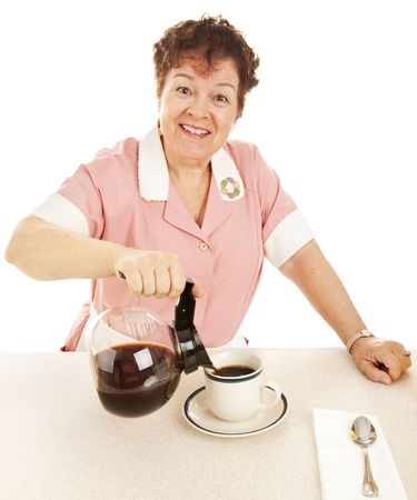 Friendly waitress at a lunch counter, pouring a cup of coffee.  Isolated on white. Stock Photo - 5562846