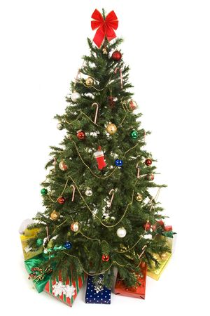 Beautiful decorated Christmas tree with colorful gifts underneath.  Fully isolated on white. photo