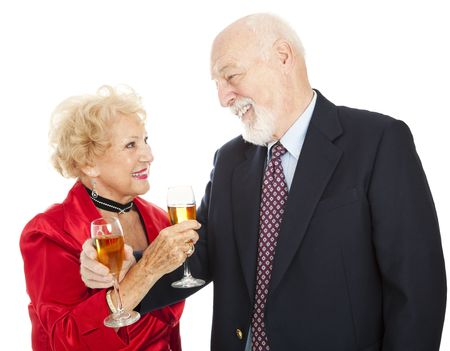 Happy senior couple making a toast with champagne.  Isolated on white.   Stock Photo - 5619465