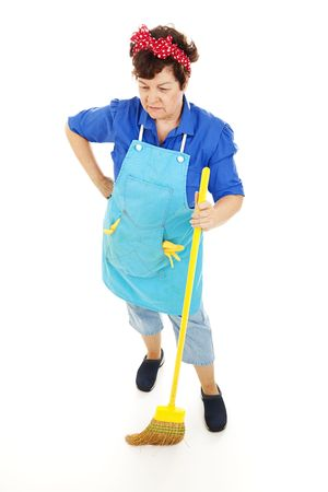 sweeps: Maid looking sad as she sweeps the floor.  Full body isolated.