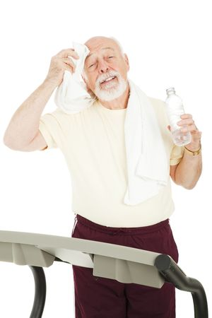 cool down: Fit healthy senior man takes a break from working out to cool down.  Isolated. Stock Photo