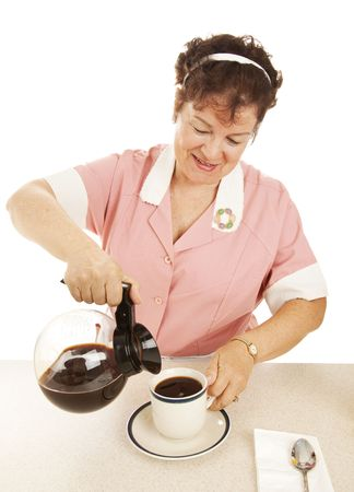 Waitress pouring a cup of coffee.  Isolated on white.   Stock Photo - 5619477