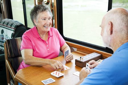 Senior couple playing a cribbage card game in their motor home.   photo