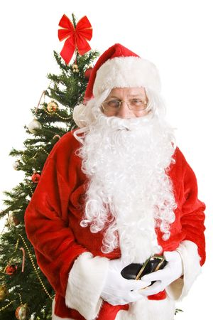 Portrait of jolly Santa Claus in front of a Christmas tree.  White background. Stock Photo - 5646561
