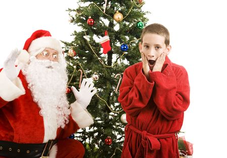 Little boy shocked to discover Santa Claus in his house.  White background.