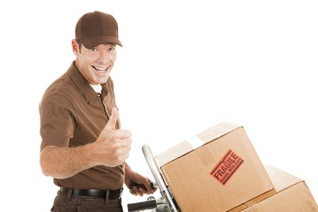 courier: Handsome delivery man with packages on a hand cart, giving a thumbs up.  Isolated on white. Stock Photo