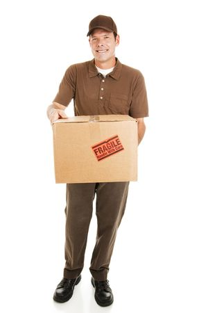 Handsome delivery man bringing a package for you.  Full body isolated on white. Stock Photo - 5719486