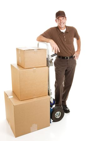hand truck: Delivery man or mover resting with a stack of boxes.  Full body isolated on white. Stock Photo