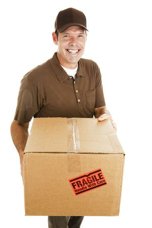 bringing: Friendly, smiling delivery man bringing a fragile package.  Isolated on white. Stock Photo