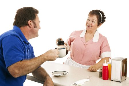 refills: Waitress in diner chats with customer and refills his coffee cup.  Isolated on white. Stock Photo