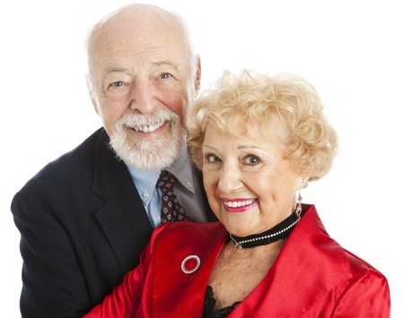 Closeup portrait of a beautiful senior couple dressed for the holidays.  Isolated on white. photo