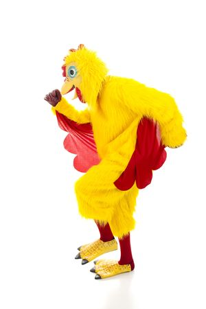 Man in a chicken suit running away.  Isolated on white.