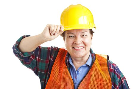 Friendly female construction worker tips her hard hat.  Closeup portrait solated on white. photo