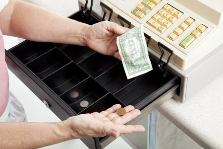 Cashier with nearly empty cash register.  Metaphor for recession. Stock Photo - 5893284