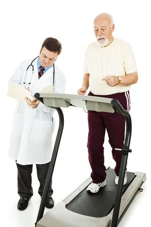 Senior man exercising on a treadmill while his doctor monitors his progress.  Isolated. photo