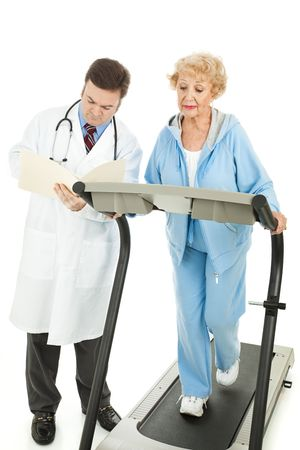 Senior woman exercising under a doctors supervision.   photo