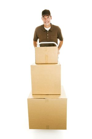 Mover or delivery man hauling a stack of boxes on his dolly.  Full body isolated. Stock Photo - 5918340