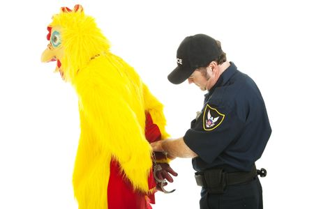 Chicken man being handcuffed by a police officer.  Isolated on white. photo