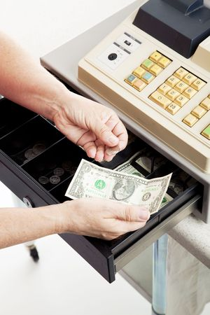Closeup of a cashier's hands making change from a cash register. Stock Photo - 5943622