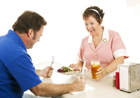 Waitress serving turkey dinner to a hungry customer.  White background Stock Photo - 5938850
