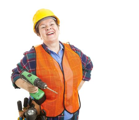 Female construction worker happy and smiling, holding her power drill.  Isolated on white. photo