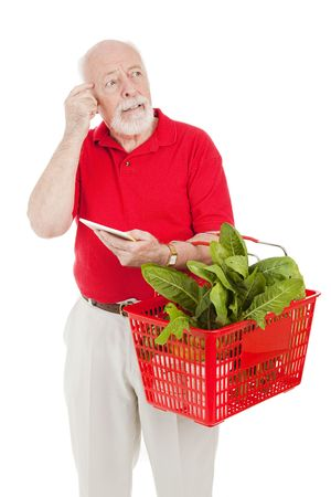 Senior man shopping for groceries has forgotten what's on his list.  Isolated on white.