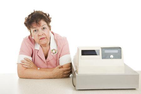 Le caissier s'ennuie parce qu'il n'y a pas de clients. Isolé sur blanc Banque d'images