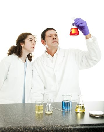 Chemistry professor and student in the lab, examining the results of an experiment.  White background. photo