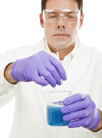 safety googles: Scientist mixing a powdered compound into a liquid one.  Focus on the contents of the beaker, with some motion blur from the stirring.
