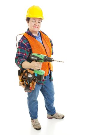 Female construction electrician using a power drill.  Isolated on white background. Stock Photo - 6230881