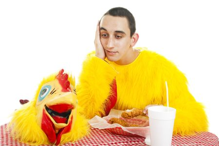 unskilled: Teen boy depressed about working in a fast food restaurant.  Hes taking a break to eat dinner.   Stock Photo